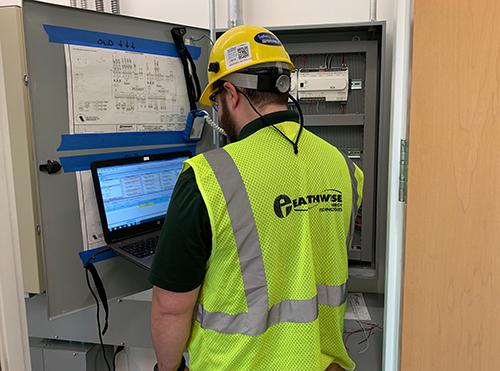 Earthwise Technician working on control panel